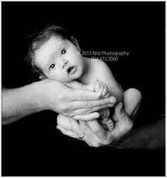 Nitz Photography Jacksonville newborn baby portrait photographer newborn baby in hands wide awak