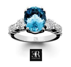 Entice. Sapphire and fancy diamond ring.  A large oval light blue Ceylon sapphire is double claw set in an elaborate ring featuring fancy cut diamond shoulders, in 18 carat white gold. Cool and sophisticated. $12,750 #entice #diamondring #fancy
