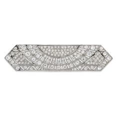 An Art Deco rectangular sunburst diamond brooch, the brooch of an open-plaque design with pointed ends, set throughout with old brilliant-cut diamonds, estimated to weigh a total of 6 carats, set to a pierced platinum mount and brooch fitting, gross weight 14.4 grams, circa 1925.
