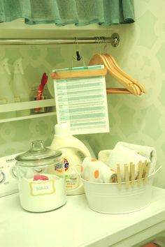 A ton of different makeover ideas for a laundry room!  I love the little ball jar being used to hold scissors (always seem to need those!) and the Tide pen!  And the clear jar holding the detergent is too cute!