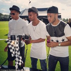 Child's play: Kieran Gibbs, his twin brother and Alex Oxlade-Chamberlain play a game of s...