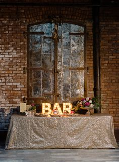 This Fresh + Romantic Industrial Wedding Inspiration from Two of a Kind Rentals and Rebecca Yale Photography features a fun bar sign and paper flower backdrop. Industrial Wedding Inspiration, Industrial Wedding Decor, Modern Industrial, Loft Wedding, Warehouse Wedding, Chic Wedding, Wedding Dreams, Wedding Props, Wedding Things