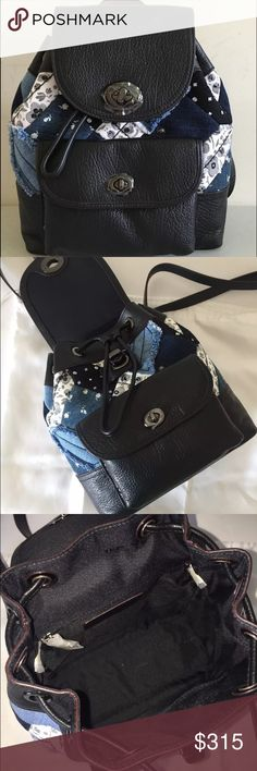 """Coach Canyon Quilted Denim mini bag BRAND NEW WITH TAG COACH   Canyon quilted denim mini rucksack Style # - 37743  Condition - Brand new w/ tag MSRP - $350.00 Color - Denim skull print Material - Leather / denim Size - 8.25"""" L x 10"""" H x 3.5"""" D Handles - Easy carry top handle Strap - Adjustable shoulder straps Closure - Flap turnlock closure w/ drawstring Futures - Front pocket w/ turnlock closure, inner zipper & slide pockets, leather hangtag, dustbag & care card included. Hardware…"""
