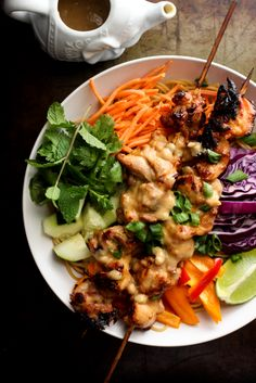 Thai Chicken Satay Noodle Salad with Creamy Coconut Peanut Dressing  I would do cilantro/mint, carrots, bell peppers, maybe cabbage or bean sprouts, and green onion.