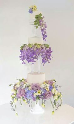 """Gorgeous wedding cake with """"floating"""" tiers and draping flowers"""