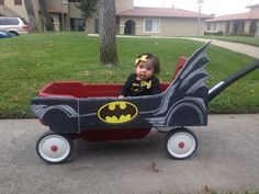 DIY Batmobile! Seriously cost like $4!!! 2 black project boards, chalk, a printout of the bat symbol and there you have it!