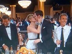 Everybody stop what you're doing and look at Jennifer Lawrence kissing Nicholas Hoult at the Golden globes!!