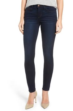 Subtle whiskering and fading add cool dimension to these deep indigo wash skinny jeans by Joe's.