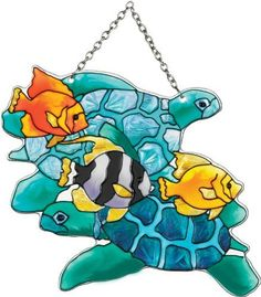 Joan Baker Designs SSD1025 Turtles and Fish Art Glass Suncatcher by Joan Baker Designs. $21.00. Vivid translucent color for window display. Chain included for convenient hanging in a window. Water-cut fired glass. Hand-painted. This hand-painted water-cut Suncatcher brings the rich sea life of a tropical reef to your window    For more than 40 years, Joan Baker Designs' talented artisans have created stunning decorative art glass items. Each piece is designed in our San C...