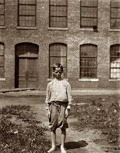 Three Weeks at It: May 1912. Rock Hill, South Carolina. Arthur Newell, doffer in Manchester Mills. Three weeks at it. 70 cents a day. Said 12 years old. His father in the mill gets 12 dollars a week, mother 9 dollars, sister 4.80 dollars, he gets 4.20 dollars, total 30 dollars a week. I had ruther go to school but the mill wanted me. Photo by Lewis Wickes Hine.