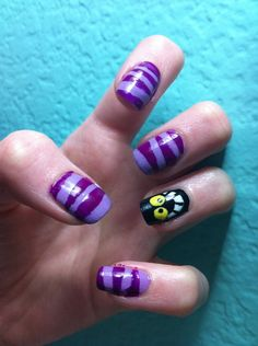 Cheshire cat nails! I really like the purple stripes!
