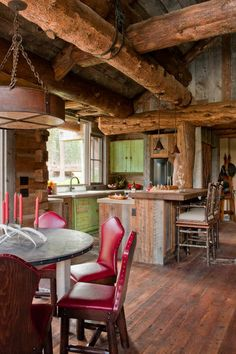 traditional kitchen by Highline Partners, Ltd love the red chairs and hewn log beams