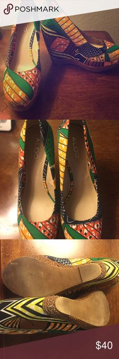 Aldo Wedges fits like a sz 9 Vibrant and colorful wedges perfect for summer time. Espadrille lining at the bottom. Gently worn. Price is negotiable. ALDO Shoes Wedges