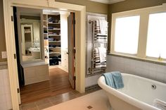 Master bathroom with soaking tub, towel warmers and walk-in closet attached.