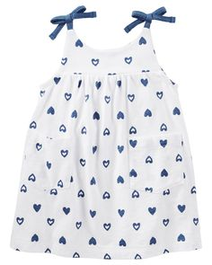 OshKosh B'gosh Baby Girls' 2 Piece Print Pocket Dress - 0-3 Months. Includes separate diaper cover. Sleeveless. Two pockets. All-over heart print. 100% cotton jersey.