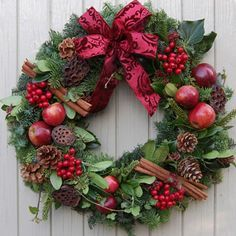 Christmas Berry wreath, bedecked with fresh red apples, pine cones, red berries and cinnamon. Christmas Door Wreaths, Christmas Flowers, Christmas Makes, Country Christmas, Outdoor Christmas, Holiday Wreaths, All Things Christmas, Christmas Time, Christmas Holidays