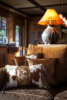 Rustic Southwest . . . love the cowhide pillow and lamp . . . Austin Cabin by High Camp Home