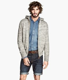Effortlessly blurring the line between sharp and laid-back, this pairing of a grey hoodie and navy denim shorts can easily become one of your favorites. Urban Outfitters, Asos, Forever 21, Revival Clothing, Zara, Blue Long Sleeve Shirt, Dapper Men, Men Looks, Grey Hoodie