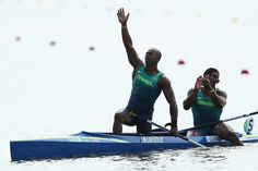 Erlon De Souza Silva and Isaquias Queiroz dos Santos of Brazil celebrate winning the silver medal in the Men's Canoe Double 1000m Finals on Day 15 of the Rio 2016 Olympic Games at the Lagoa Stadium on August 20, 2016 in Rio de Janeiro, Brazil.