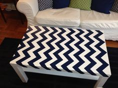 My chevron navy and white table. $5 ikea coffee table from Craigslist, symphony blue paint by Benjamin Moore (just one sample jar), and frog tape. Don't forget to paint over the edges of tape with bottom color to avoid bleeding of top color (but first sand and prime, especially if its not real wood like this). Spray paint clear so you wont worry about your artwork being ruined and stained. And ta-da! A one of a kind coffee table!