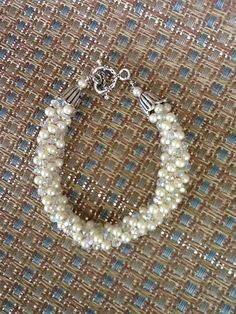 Kumihimo bracelet (love the white on white) crystal and pearl