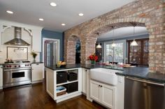 like opening into other room....kitchen with brick walls and white cabinets | How to integrate exposed brick walls into your interior décor