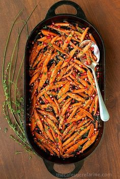 Mouthwatering Recipes to Help You Win Thanksgiving: Carrots get an elegant treatment in this colorful, pomegranate-studded side dish.