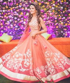A floral wall and a bride in peach . What's not to love ? New on the WedMeGood app inspiration gallery shot by @design_aqua_studio | #lehenga #indianbride #indianwedding #wedding #bridal #brides #bridalicilous #weddingday #mehendilehenga #indianwear #indianfashion #fashion #weddings #fashion #ombre