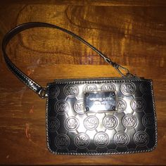 Michael Kors metallic wristlet MK wristlet. Used a few times. Has adorable metallic with MK all over it! Perfect for when you don't want to lug around that purse! Michael Kors Bags Clutches & Wristlets