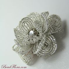 "French Silver Goddess beaded flower--This pinner has a lot of beaded flowers on her board ""Crafts"""
