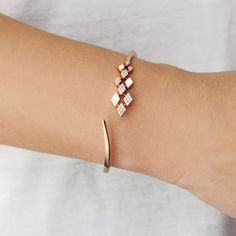 Staggered diamond and yellow gold diamond-shaped cuff bracelet. http://www.thesterlingsilver.com/product/esse-marcasite-sterling-silver-fresh-water-pearl-and-marcasite-flower-girl-bracelet-with-fancy-clasp-17cm-long/ #braceletdiamonds