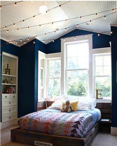 I love this room. Color- windows, platform bed, built in dresser. Quilt. Lighting. E