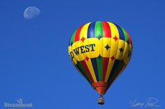 The moon and a hot air balloon stand out in a bluebird Steamboat sky.   Steamboat Springs, Colorado