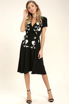 Be the hostess with the mostess in the I Heart You Black Embroidered Midi Dress! Lightweight woven rayon , with lovely ivory floral embroidery, shapes a surplice bodice (with modesty snap) and short sleeves. Elasticized waist with tying sash tops a full midi skirt.