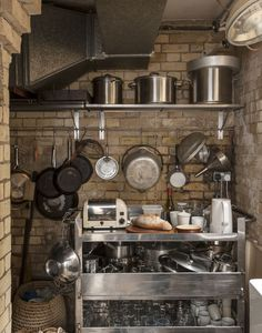 A yellow brick-walled skullery off the kitchen is for storage and washing up; food staples are stored in an adjacent pantry. The stainless s...