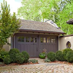 A new set of doors enhance the charm of this stuccoed garage. Details all around add to the richness. via:bhg