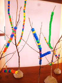 On a beautiful sunny spring morning some of the children were intrigued by the provocation of small twiggy branches, beautiful tiny beads...