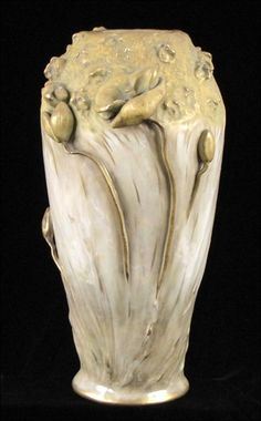 AMPHORA ART NOUVEAU POTTERY VASE. Tapered form with faces and flowers in high relief; Marked on bottom Height: 15.50""