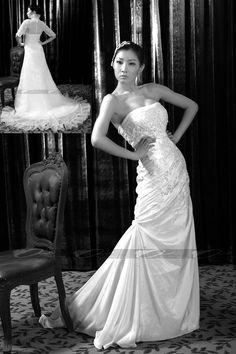 Strapless taffeta wedding gown with organza coat