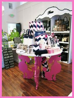 Not the Pink Poodle Table, but good concept for display table and dress up for book shelf.