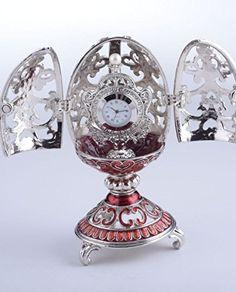 Silver & Red Faberge Egg Trinket Box with a Pearl and a Clock Inside Keren Kopal http://www.amazon.com/dp/B016UQ0WBE/ref=cm_sw_r_pi_dp_EXdDwb0FC4S83