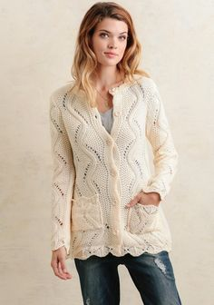 Add a hint of warmth and texture to your outfit with this adorable cream-colored cardigan! Crafted with a unique cable-knit design with small cutouts throughout, this soft cardigan features but...