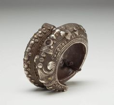 Indonesia ~ Sumatra. Golang Tangan (bracelet) from the Batak (Toba) people. Silver. This bracelet is decorated with masculine emblems of power, the 'naga' and the 'singa'.