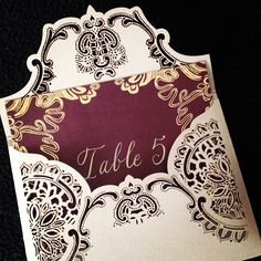 Laser cut escort card and envelope with lace detailing