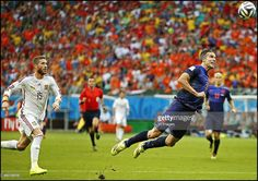 Robin van Persie scores during the FIFA World Cup 2014 groupstage group B match between Spain and Netherlands on June 13, 2014 at the Arena Fonta Nova in Salvador, Brazil.