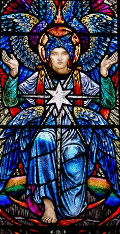 Stained glass seraphim by Karl Parsons 1930.  Ansley, St Laurence