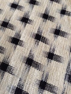 Handloomed white and black cross cotton Ikat fabric by Carol Ziogas and Thomas of California-based kimonomomo