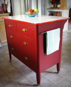 Dresser turned into Kitchen Island.  Took dumpy, yellow dresser and added vintage bin handles, paint, large towel bars and repurposed vintage enamel table top!  Practical and pretty too!