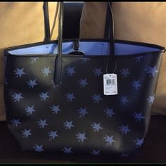 Brand New Coach Purse Coach Purse Brand New with tags. I bought it and it's beautiful. It's black/Blue stars. $325.00 New Coach Bags Totes