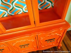 Retro orange china cabinet transformation... with hand-painted pattern on backboard! {Sawdust and Embryos}